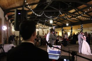 Professional MC & Host helping direct the wedding